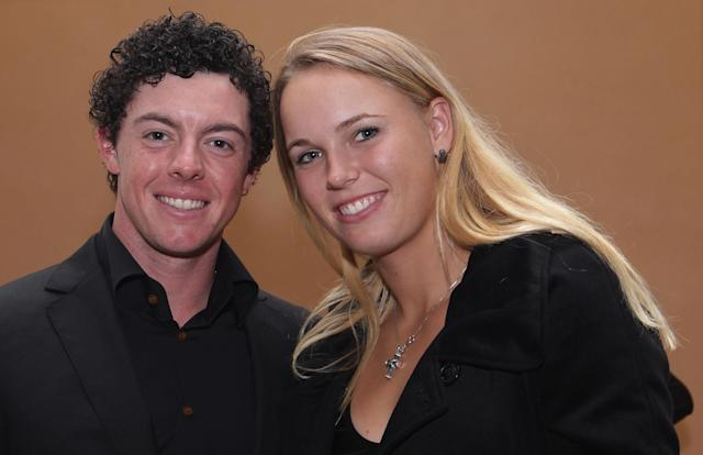 SHANGHAI, CHINA - NOVEMBER 01: Rory McIlroy of Northern Ireland (L) poses alongside his girlfriend Caroline Wozniacki of Denmark during the Welcome Reception at the Waitanyuan prior to the start of the WGC-HSBC Champions on November 1, 2011 in Shanghai, China. (Photo by Ross Kinnaird/Getty Images)