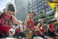 The Batala Drum Line play while marching alongside people at the Queer Liberation March on Sunday, June 27, 2021, in New York. (AP Photo/Brittainy Newman)