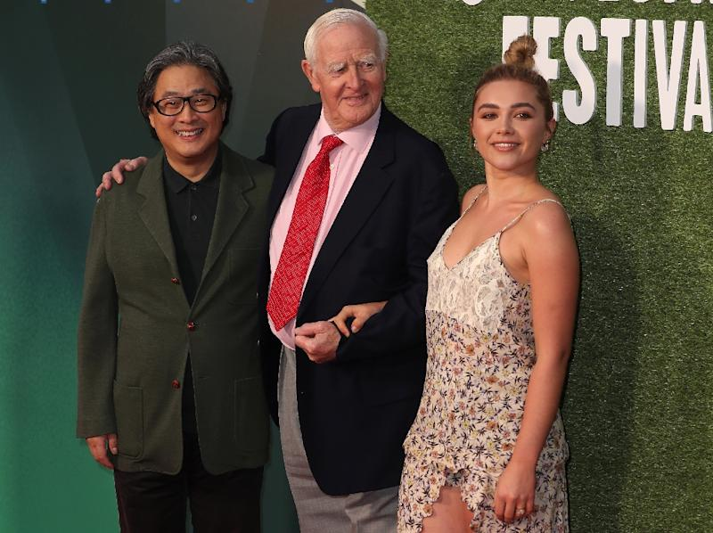 """Korean director Park Chan-wook (L), British author John le Carre (David John Moore Cornwell) and British actor Florence Pugh (R)at the world premiere of """"The Little Drummer Girl"""", the only TV series showcased at the London film festival"""