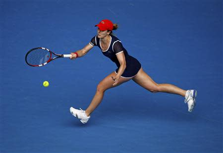 Alize Cornet of France hits a return to Maria Sharapova of Russia during their women's singles match at the Australian Open 2014 tennis tournament in Melbourne January 18, 2014. REUTERS/Jason Reed