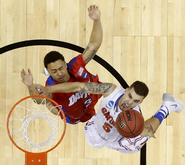 Florida guard Scottie Wilbekin (5) shoots over Dayton guard Kyle Davis (3) during the first half in a regional final game at the NCAA college basketball tournament, Saturday, March 29, 2014, in Memphis, Tenn. (AP Photo/John Bazemore)