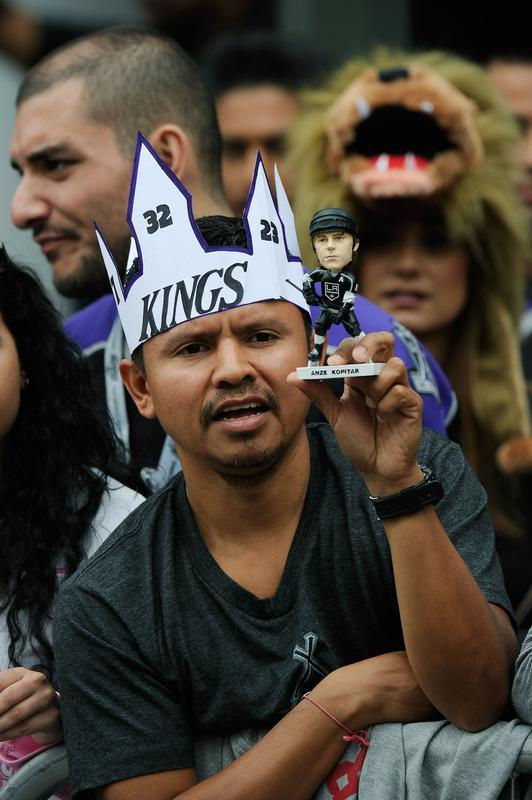 LOS ANGELES, CA - JUNE 14: Hugo Miranda hold an Anze Kopitar bobble head doll during the Stanley Cup victory parade on June 14, 2012 in Los Angeles, California. The Kings are celebrating their first NHL Championship in the team's 45-year-old franchise history. (Photo by Kevork Djansezian/Getty Images)