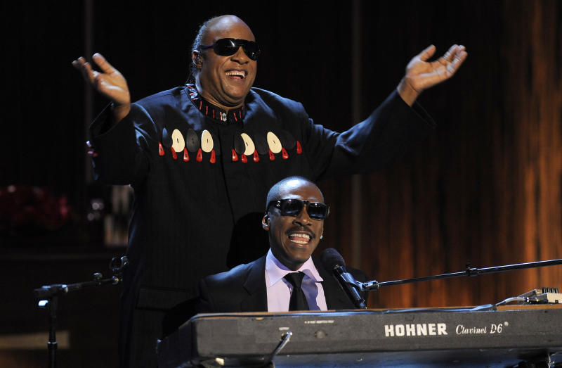 """Eddie Murphy, bottom, and Stevie Wonder perform Wonder's song """"Higher Ground"""" onstage during """"Eddie Murphy: One Night Only,"""" a celebration of Murphy's career at the Saban Theater on Saturday, Nov. 3, 2012, in Beverly Hills, Calif. (Photo by Chris Pizzello/Invision)"""