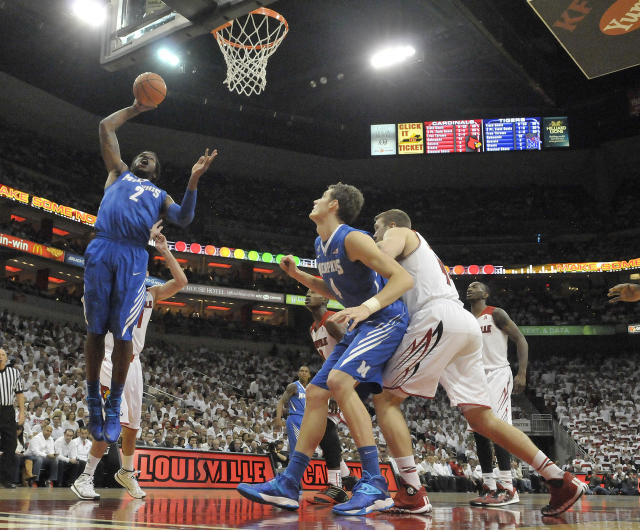 Memphis' Shaq Goodwin, left, goes up to dunk during the first half of an NCAA college basketball game against Louisville, Thursday, Jan. 9, 2014, in Louisville, Ky. Memphis defeated Louisville 73-67. (AP Photo/Timothy D. Easley)