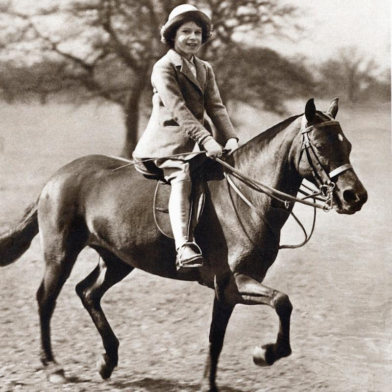The Queen as a little girl riding in Windsor - Hulton