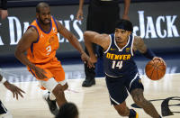 Denver Nuggets guard Gary Harris, right, drives past Phoenix Suns guard Chris Paul during the second half of an NBA basketball game Friday, Jan. 1, 2021, in Denver. The Suns won 106-103. (AP Photo/David Zalubowski)