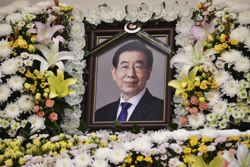 "In this photo provided by Seoul Metropolitan Government, a portrait of the deceased Seoul Mayor Park Won-soon is placed at a hospital in Seoul, South Korea, Friday, July 10, 2020. Seoul's mayor left a note saying he felt ""sorry to all people"" before he was found dead early Friday, officials in the South Korean capital said as people began mourning the liberal legal activist seen as a potential presidential candidate. (Seoul Metropolitan Government via AP)"