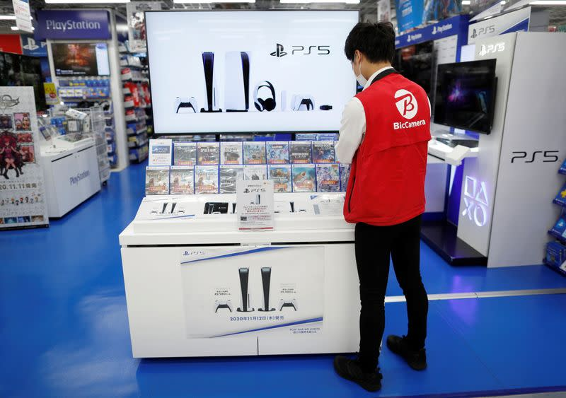 An employee works at the promotion display for the Sony PlayStation 5 game console and its gaming softwares in Tokyo