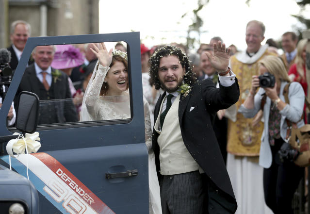 Kit Harington and Rose Leslie leave Rayne Church following their wedding ceremony. (Jane Barlow/PA via AP)