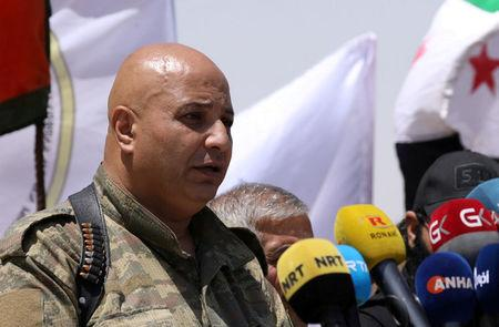 FILE PHOTO: Then SDF spokesman Talal Silo speaks during a press conference in Hukoumiya village in Raqqa