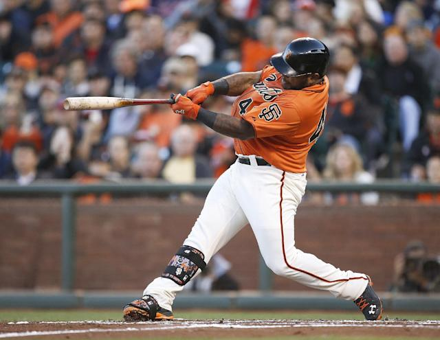 San Francisco Giants' Pablo Sandoval hits a three-run home run off Minnesota Twins starting pitcher Kyle Gibson in the first inning of a baseball game Friday, May 23, 2014, in San Francisco. (AP Photo/Tony Avelar)