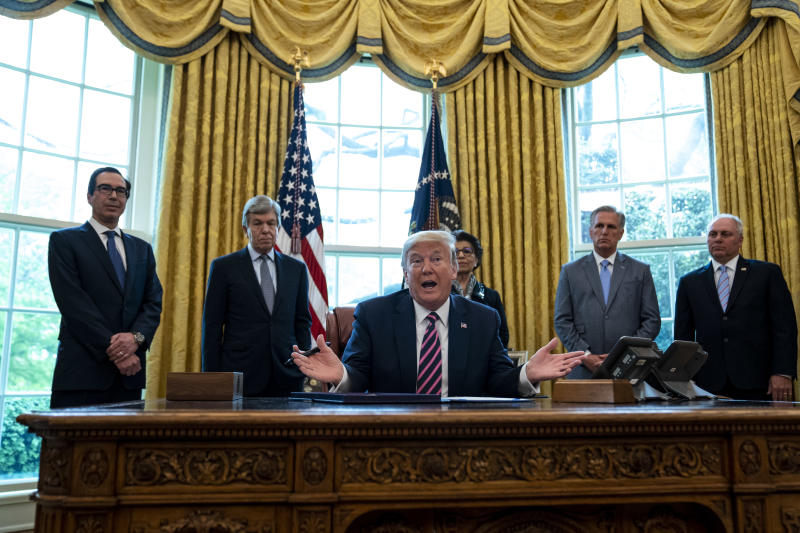 WASHINGTON, DC - APRIL 24: U.S. President Donald Trump participates in a signing ceremony for H.R.266, the Paycheck Protection Program and Health Care Enhancement Act, with members of his administration and Republican lawmakers in the Oval Office of the White House in Washington DC on April 24th, 2020. The bill includes an additional $321 billion for the Paycheck Protection Programs forgivable loans to cover payroll and other costs for small businesses. Hospitals and other health care providers will receive $75 billion and another $25 billion is allocated for COVID-19 testing. (Photo by Anna Moneymaker/The New York Times/POOL/Getty Images)
