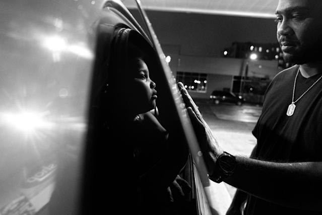 <p>Billy Garcia and daughter Esmeralda enjoy a tender moment at a gas station, Bronx, N.Y., 2012. (Photograph © Zun Lee) </p>