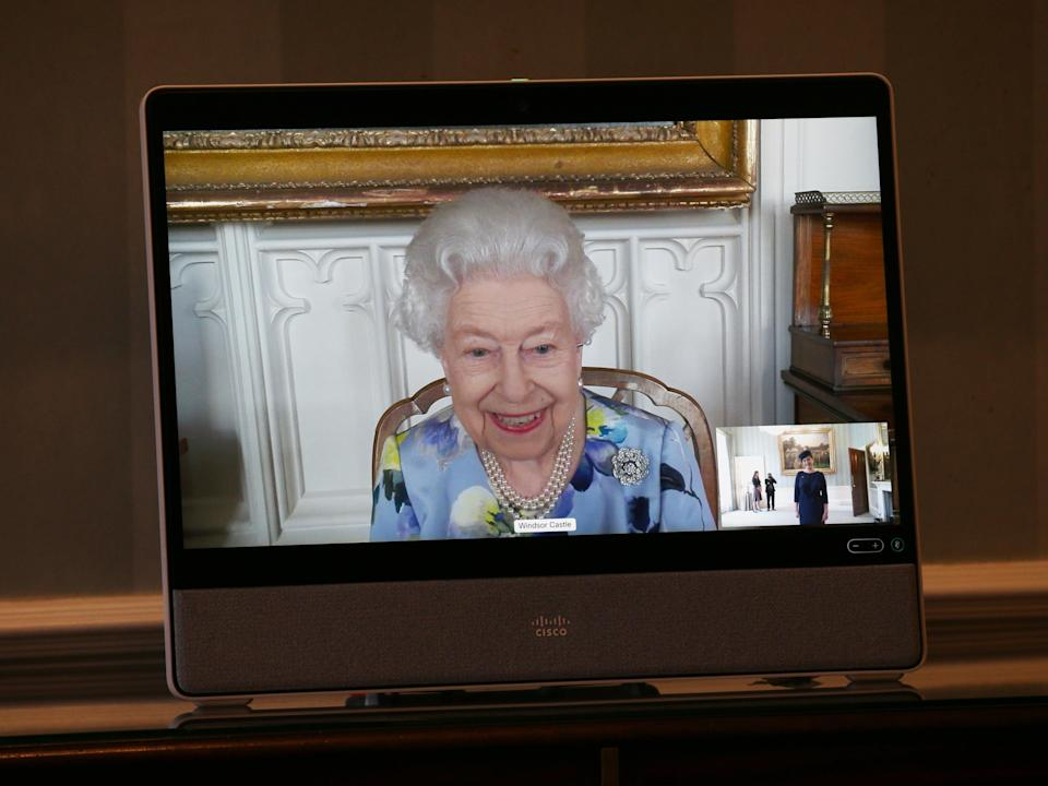 The Queen appears on a screen by videolink from Windsor Castle (PA Wire)