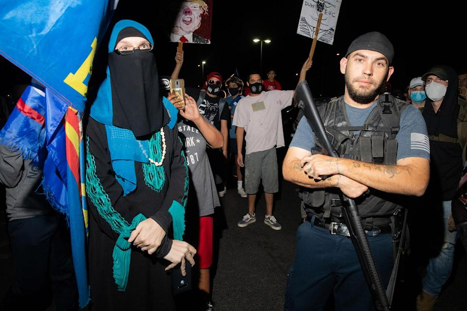 Trump supporters with counter protesters at the Mariscopa County Elections Office in Phoenix, AZ on November 4, 2020