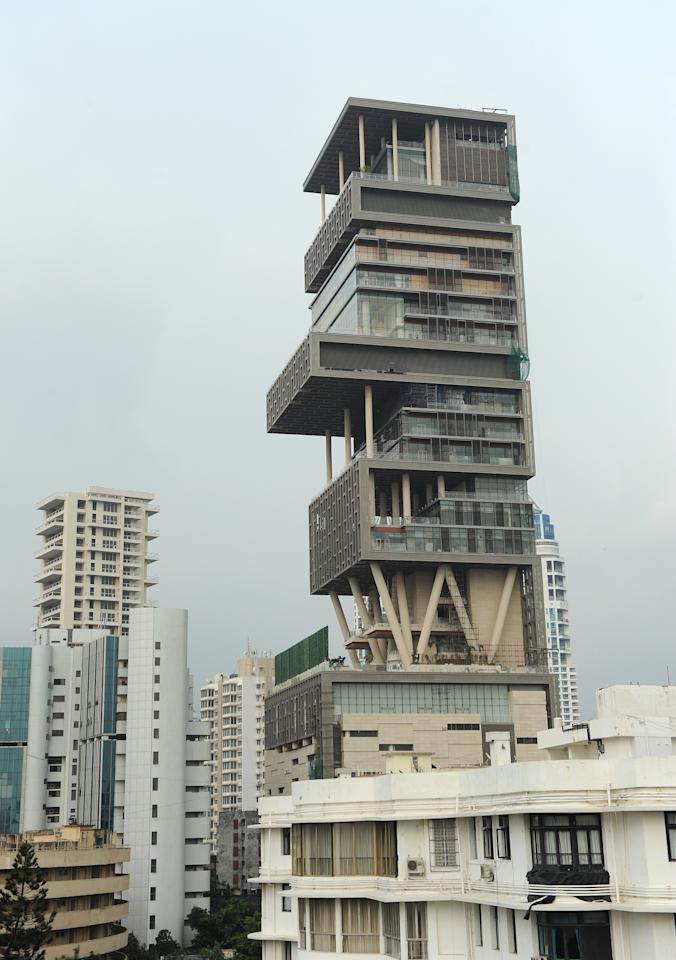 The twenty-seven storey Antilia, the newly-built residence of Reliance Industries chairman Mukesh Ambani, is seen in Mumbai on October 19, 2010. The 400,000 square foot residence, named after a mythical island in the Atlantic, is expected to be occupied by Ambani, his wife and three children later in the year. The building has three helicopter pads, underground parking for 160 cars, and requires some 600 staff to run. AFP PHOTO/Indranil MUKHERJEE