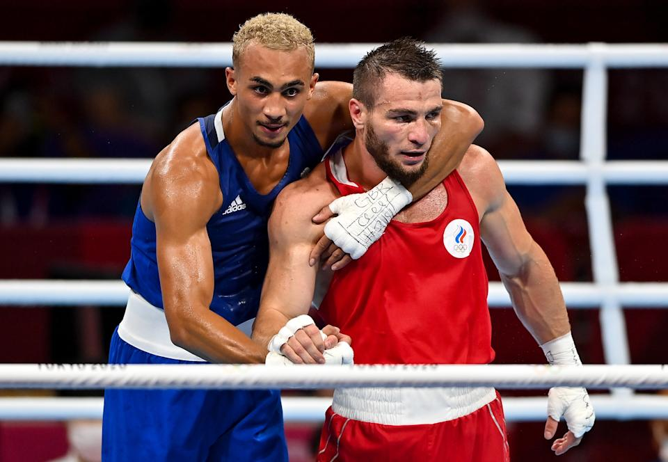 Tokyo , Japan - 1 August 2021; Ben Whittaker of Great Britain, left, and Imam Khataev of Russian Olympic Committee after their men's light heavyweight semi-final bout at the Kokugikan Arena during the 2020 Tokyo Summer Olympic Games in Tokyo, Japan. (Photo By Brendan Moran/Sportsfile via Getty Images)