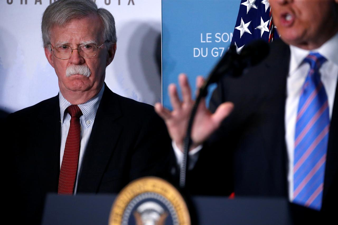 <p>National Security Advisor John Bolton watches as President Donald Trump gives a news briefing at the G7 Summit in the Charlevoix city of La Malbaie, Quebec, Canada, June 9, 2018. (Photo: Leah Millis/Reuters) </p>