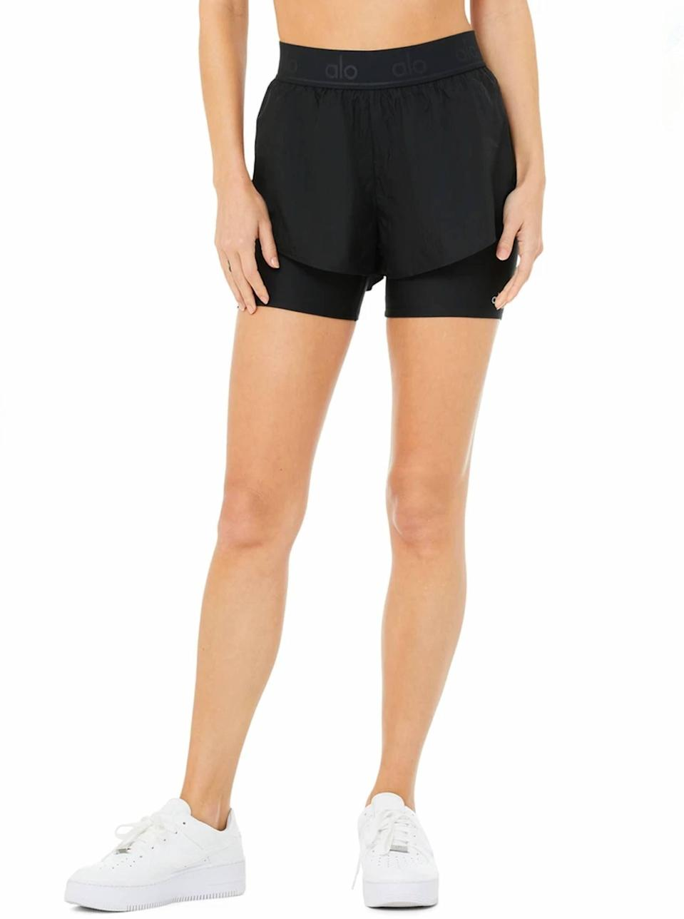 """""""Whoever invented shorts with liners is a genius IMO. These are the perfect hybrid of tiny <a href=""""https://www.glamour.com/story/best-bike-shorts?mbid=synd_yahoo_rss"""" rel=""""nofollow noopener"""" target=""""_blank"""" data-ylk=""""slk:bike short tights"""" class=""""link rapid-noclick-resp"""">bike short tights</a> plus regular run shorts—and the extra coverage means I can get in a post-run stretch without having to worry about flashing passersby. But the best part about these shorts is that the liners don't run up. Nothing's worse than having to adjust down-there every five steps."""" —<em>Talia Abbas, associate commerce editor</em> $72, Alo Yoga. <a href=""""https://www.aloyoga.com/products/w6207r-high-waist-catch-the-light-short-black"""" rel=""""nofollow noopener"""" target=""""_blank"""" data-ylk=""""slk:Get it now!"""" class=""""link rapid-noclick-resp"""">Get it now!</a>"""