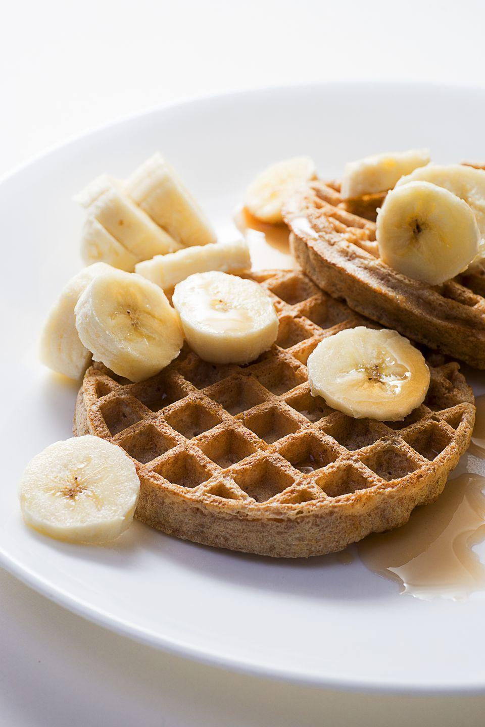 "<p>Toast 1 <a href=""https://www.amazon.com/Vans-Grains-Waffles-Totally-Orginal/dp/B00CJ5U2IE?tag=syn-yahoo-20&ascsubtag=%5Bartid%7C10055.g.4351%5Bsrc%7Cyahoo-us"" rel=""nofollow noopener"" target=""_blank"" data-ylk=""slk:100% whole-grain frozen waffle"" class=""link rapid-noclick-resp"">100% whole-grain frozen waffle</a>, spread with 2 tablespoons <a href=""https://www.goodhousekeeping.com/health/diet-nutrition/a19503705/almonds-nutrition/"" rel=""nofollow noopener"" target=""_blank"" data-ylk=""slk:nut butter"" class=""link rapid-noclick-resp"">nut butter</a>, and top with 1 small sliced banana plus cinnamon and nutmeg. Serve with 8 ounces fat-free milk.</p>"