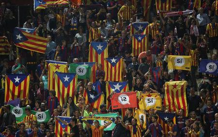 Fans raise pro-independence flags and banners during a Spanish La Liga match between Girona and Barcelona at Montilivi stadium in Girona, Spain, September 23, 2017. Picture taken September 23, 2017.  REUTERS/Albert Gea