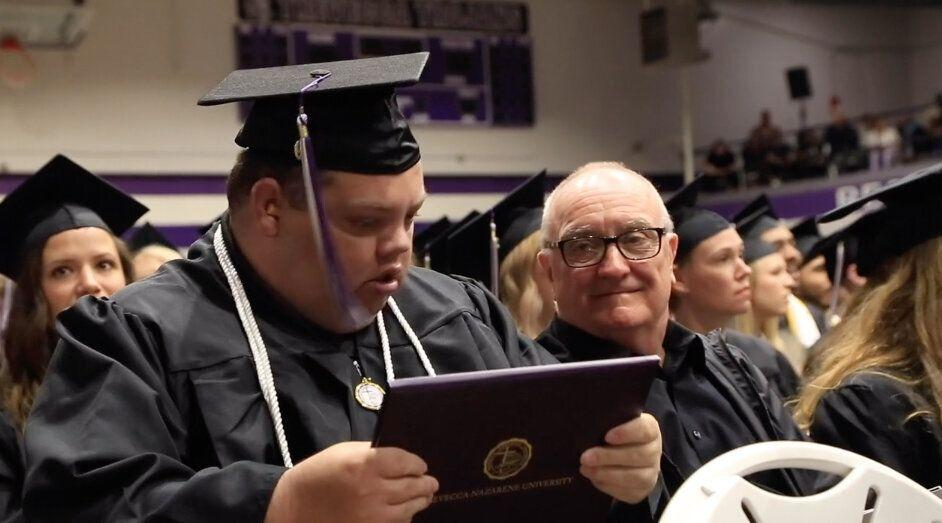 Brian Schnelle sits with his father Jeff at the Trevecca Nazarene University. (Credit: Trevecca Nazarene University)