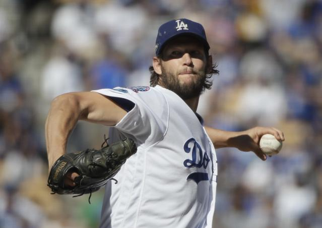 Clayton Kershaw will remain with the Los Angeles Dodgers after agreeing to a three-year, $93 million extension. (AP)