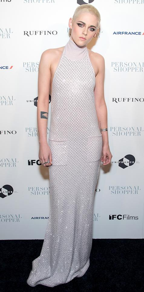 <p>Kristen Stewart dazzled on the red carpet in a glimmering metallic knit gown (look closer--there are pockets!) for the premiere of her latest film Personal Shopper. The star kept the focus on the dress by accessorizing minimalistically with just a couple silver rings and a matching arm bangle.</p>