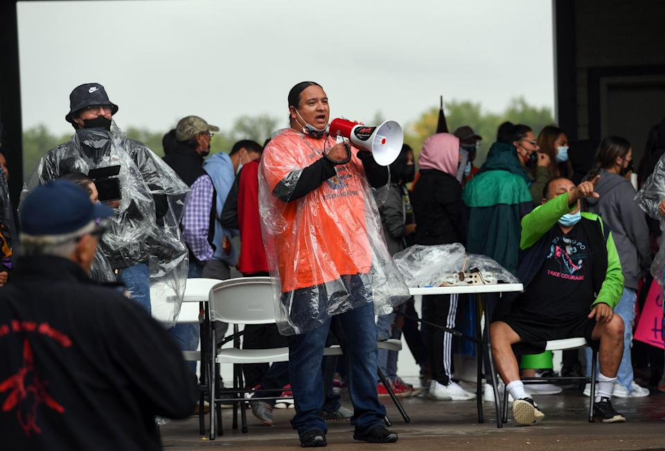 NDN Collective president and CEO Nick Tilsen speaks into a megaphone before a demonstration through the streets of Pierre after the final draft of the state's proposed social studies standards left out multiple specific references to the Oceti Sakowin on Monday, September 13, 2021.