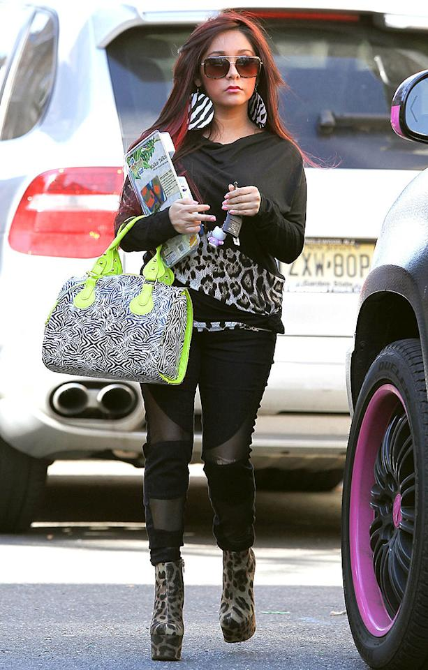Zebras and tigers and cheetahs, oh my! Snooki never met an animal print she didn't love.