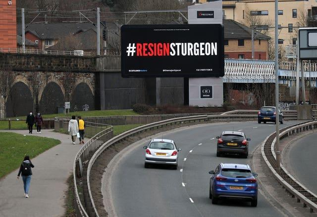 A digital billboard in Glasgow showing the words #ResignSturgeon