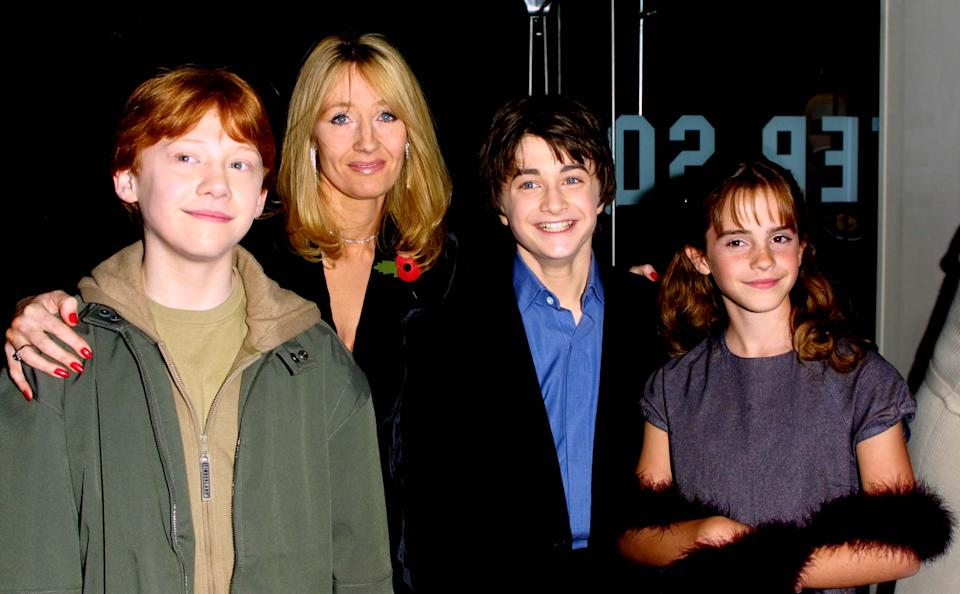 LONDON - NOVEMBER 4:   Actors Rupert Grint, Author JK Rowling, Daniel Radcliffe and Emma Watson attend the world premiere of the first Harry Potter film, 'Harry Potter and the Philosopher's Stone' at the Odeon Leicester Square, London, November 4, 2001. (Photo by Gareth Davies/Getty Images)