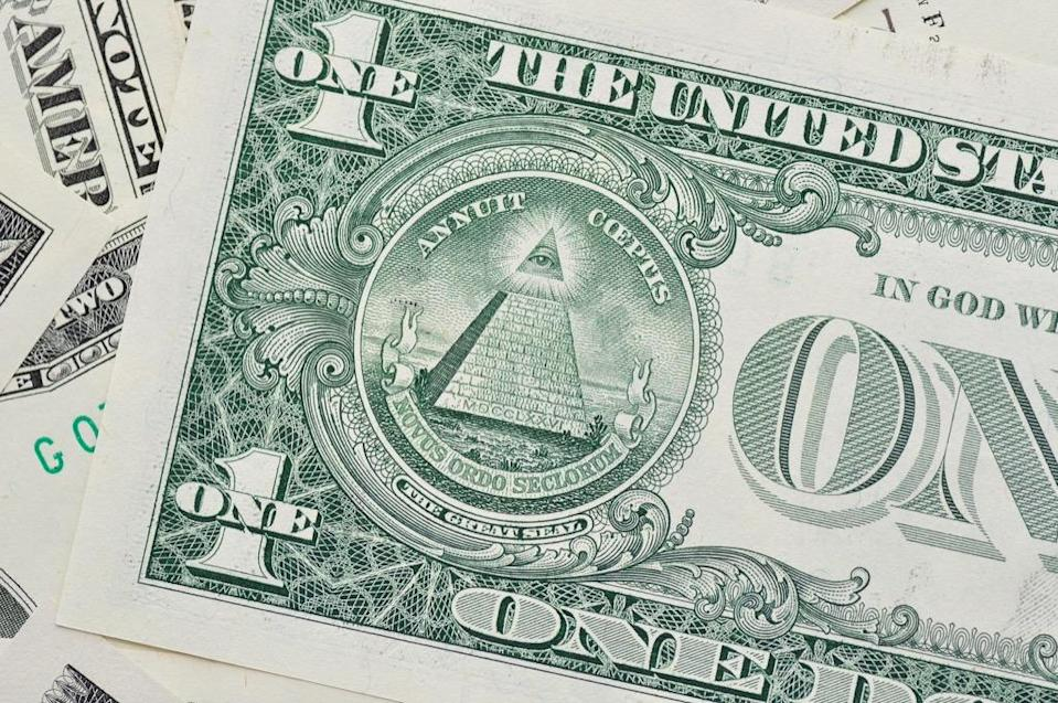 """The <a href=""""https://www.philadelphiafed.org/education/teachers/publications/symbols-on-american-money/"""" rel=""""nofollow noopener"""" target=""""_blank"""" data-ylk=""""slk:pyramid on the back of the bill"""" class=""""link rapid-noclick-resp"""">pyramid on the back of the bill</a> represents the young <a href=""""https://bestlifeonline.com/united-states-facts/?utm_source=yahoo-news&utm_medium=feed&utm_campaign=yahoo-feed"""" rel=""""nofollow noopener"""" target=""""_blank"""" data-ylk=""""slk:United States"""" class=""""link rapid-noclick-resp"""">United States</a>, with 13 steps representing the original 13 colonies, and an unfinished top reflecting the growing and expanding the country still had to do. The """"Eye of Providence"""" at the top represents an all-seeing god—but not, as some conspiracy theorists would tell you, the Illuminati. And for more fascinating facts, check out <a href=""""https://bestlifeonline.com/useless-facts/?utm_source=yahoo-news&utm_medium=feed&utm_campaign=yahoo-feed"""" rel=""""nofollow noopener"""" target=""""_blank"""" data-ylk=""""slk:100 Totally Useless Facts That Are Too Entertaining for Words"""" class=""""link rapid-noclick-resp"""">100 Totally Useless Facts That Are Too Entertaining for Words</a>."""