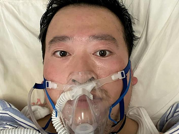 The risks facing medical staff were highlighted after Li Wenliang, a whistleblowing doctor in Wuhan, succumbed to the disease (AFP Photo/Li WENLIANG)