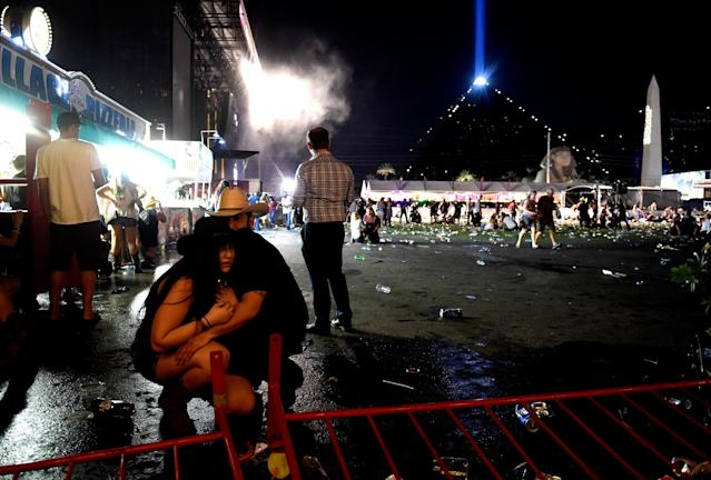 <p>People take cover at the Route 91 Harvest country music festival after apparent gun fire was heard on Oct. 1, 2017 in Las Vegas. (Photo: David Becker/Getty Images) </p>