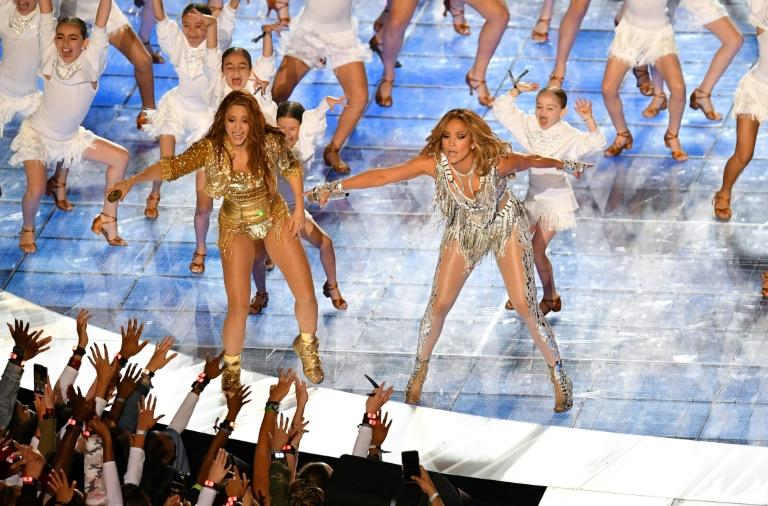 US singer Jennifer Lopez (R) and Colombian singer Shakira (L) perform during the halftime show of Super Bowl LIV between the Kansas City Chiefs and the San Francisco 49ers at Hard Rock Stadium in Miami Gardens, Florida