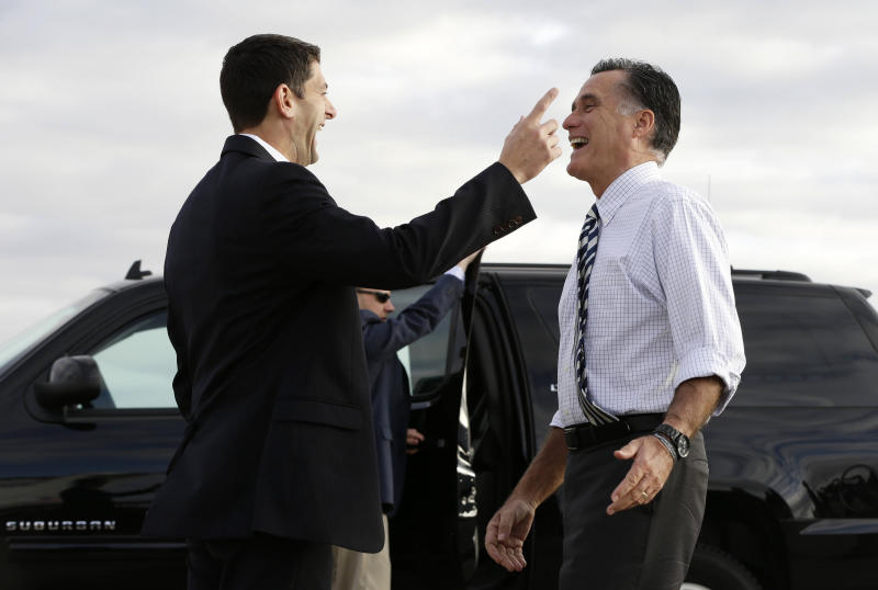 Republican presidential candidate, former Massachusetts Gov. Mitt Romney and his running mate, Rep. Paul Ryan, R-Wis. share a laugh as Romney bids Ryan farewell before boarding his campaign plane in Denver, Colo., Wednesday, Oct. 24, 2012, as he travels to campaign events in Reno, Nev. Ryan was heading to Ohio to campaign. (AP Photo/Charles Dharapak)