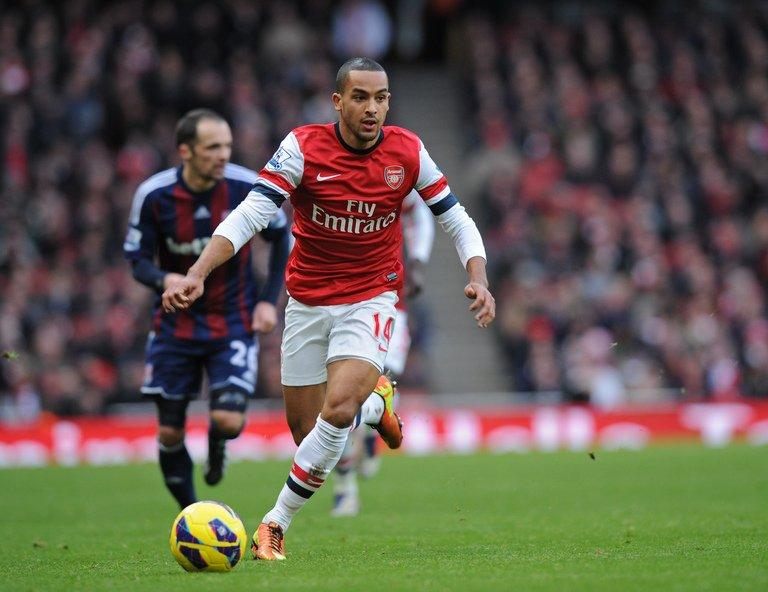 Arsenal striker Theo Walcott dribbles against Stoke City on February 2, 2013