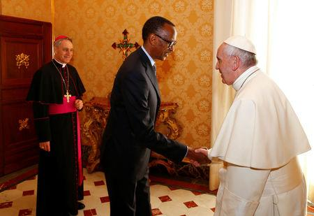 Rwanda's President Paul Kagame is welcomed by Pope Francis during a private meeting at the Vatican March 20, 2017. REUTERS/Tony Gentile