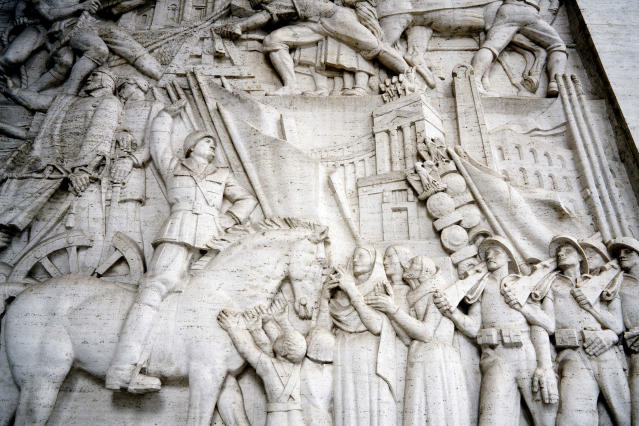 """A detail of a giant marble bas-relief titled """"The Story of Rome through its Constructions"""", made in 1940 by sculptor Publio Morbiducci, shows Italian dictator Benito Mussolini on horseback, at the entrance of a building in the EUR neighborhood of Rome, Monday, May 6, 2019. Mussolini transformed Rome's urban landscape with grand construction projects like EUR, a new city district that was originally designed as celebration of fascism for a world fair in 1942. The fair was canceled due to WWII and construction was halted but resumed after the war. (AP Photo/Andrew Medichini)"""