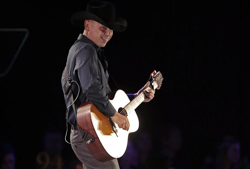 Kenny Chesney performs during a tribute to songwriter Dean Dillon at the BMI Country Awards on Tuesday, Nov. 5, 2013, in Nashville, Tenn. (AP Photo/Mark Humphrey)