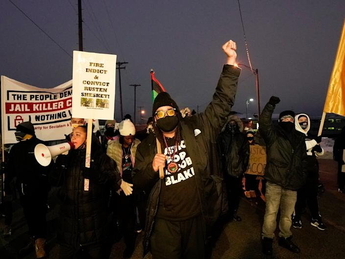 In this January 4, 2021 file photo, Jacob Blake's uncle Justin Blake directs the march in Kenosha, Wisconsin.  (AP)