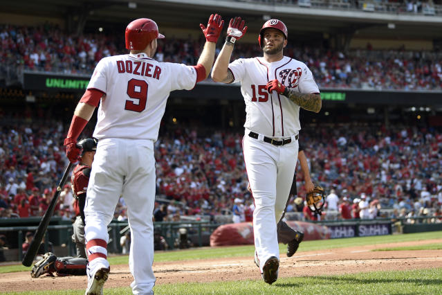 Washington Nationals' Matt Adams (15) celebrates his home run with Brian Dozier (9) during the first inning of a baseball game against the Arizona Diamondbacks, Saturday, June 15, 2019, in Washington. (AP Photo/Nick Wass)