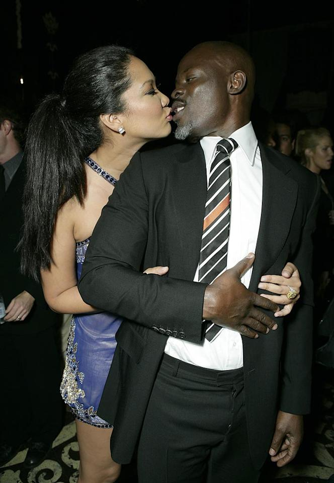 "Kimora Lee Simmons clearly prefers Djimon Hounsou's lips to those of her ex, mogul Russell Simmons. Todd Williamson/<a href=""http://www.wireimage.com"" target=""new"">WireImage.com</a> - March 4, 2008"
