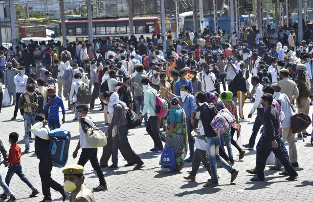 NEW DELHI, INDIA - MARCH 28: Migrant workers are seen in large numbers at Kaushambi Roadways Bus Stand on Day 4 of the 21 day nationwide lockdown -- to check the spread of coronavirus, at Kaushambi, on March 28, 2020 in New Delhi, India. (Photo by Ajay Aggarwal/Hindustan Times via Getty Images)