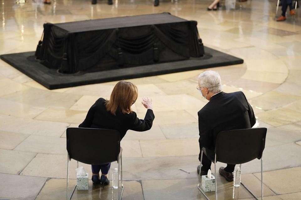 <p>Democratic Representative from California and Speaker of the House Nancy Pelosi (L) and Republican Senator from Kentucky and Senate Majority Leader Mitch McConnell (R) speak during a ceremony preceding the lying in state of US Representative from Georgia John Lewis in the Rotunda of the US Capitol in Washington, DC, on July 27, 2020</p>