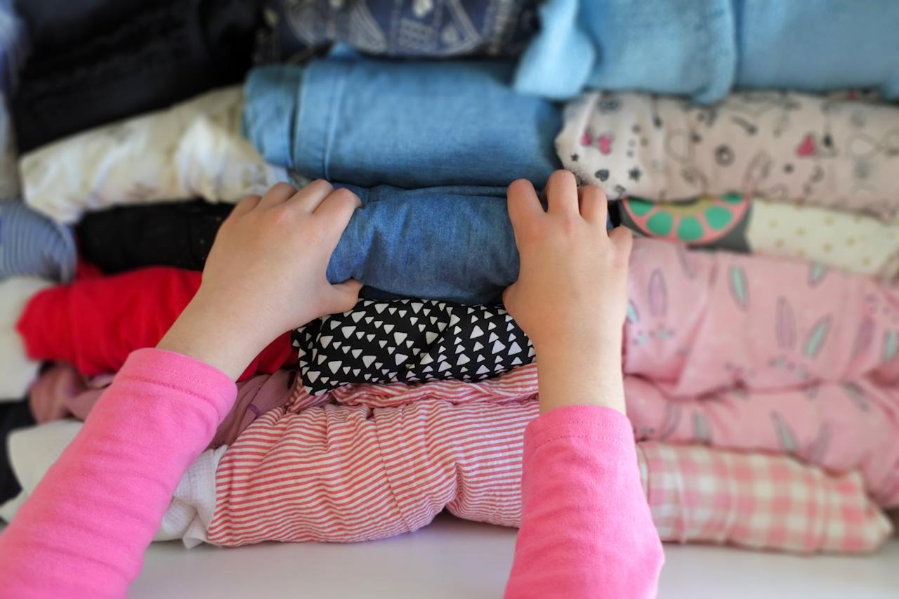 <p>Kid clothing is one of those things that you should stay on top of regularly, but if you haven't weeded through your children's closets recently, now's the time. Stained or ripped clothing goes in the garbage; lightly worn, outgrown items should go in the donation or hand-me-down pile. Clothes that still fit should be organized by type (T-shirts, dresses, sweatshirts, etc.) to encourage your kids to dress themselves.</p>