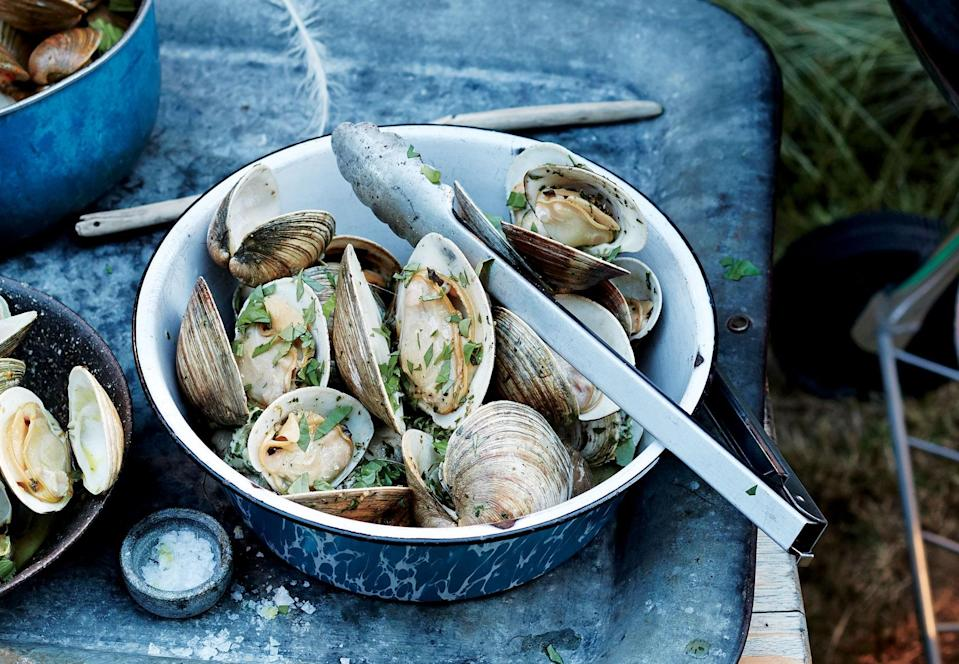 "When you toss hot clams right off the grill with some flavored butter, the butter melts and mingles with the clam liquor, creating an irresistible combination. <a href=""https://www.bonappetit.com/recipe/grilled-clams-lemon-shallot-butter?mbid=synd_yahoo_rss"" rel=""nofollow noopener"" target=""_blank"" data-ylk=""slk:See recipe."" class=""link rapid-noclick-resp"">See recipe.</a>"