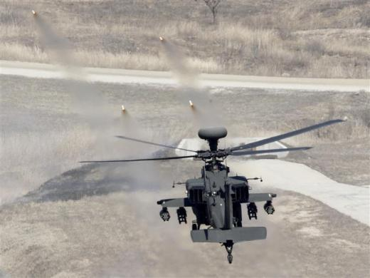 A U.S. AH-64 Apache helicopter fires missiles during a live fire gunnery exercise with the South Korean army at the U.S. army's Rodriguez range in Pocheon, 9 miles south of the demilitarized zone, April 15, 2010.