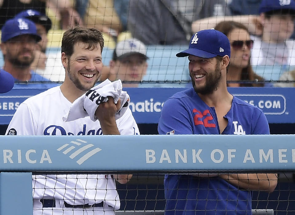 Los Angeles Dodgers starting pitcher Rich Hill, left, and Clayton Kershaw talk in the dugout during the seventh inning of a baseball game against the Philadelphia Phillies, Sunday, June 2, 2019, in Los Angeles. (AP Photo/Mark J. Terrill)